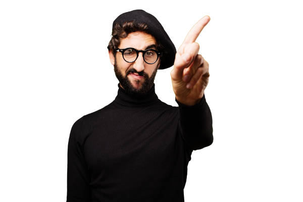 Creative man wearing black turtleneck and beret, shaking his index finger, showing that he refuses to receive payment in exposure.