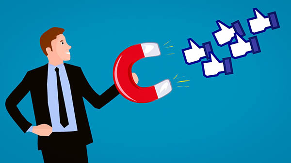 Graphic of a man in a suit, holding on a horseshoe magnet, attracting likes, to indicate the importance of social media. Is a social media manager a content creator?